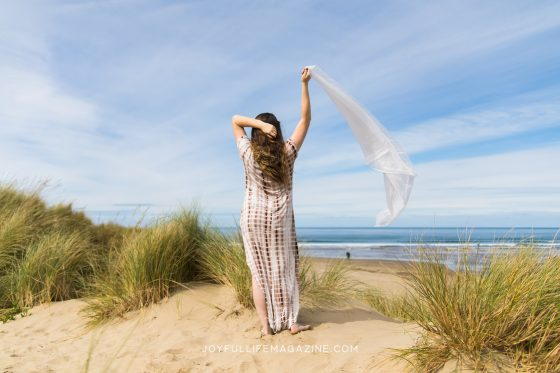 waiting on a promise from God | a woman stands looking at the ocean