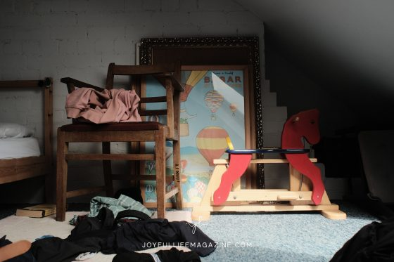 Kid's room with wooden chair and red rocking horse