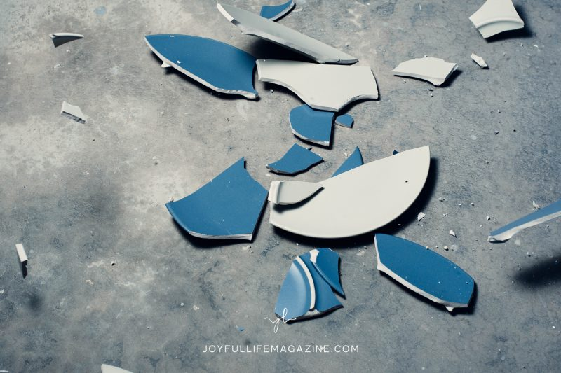 Broken blue plates on a gray background