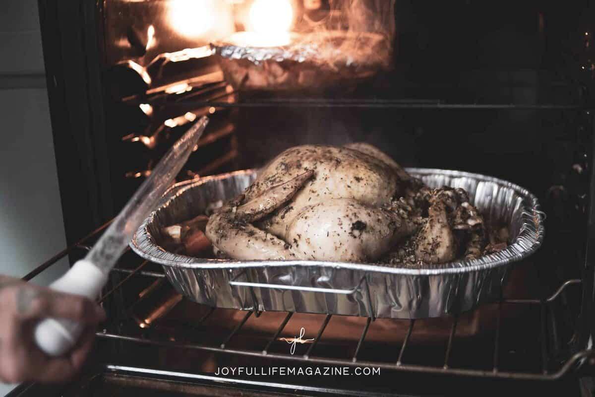 Turkey in roasting pan in oven.