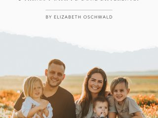 couple with three kids smiling