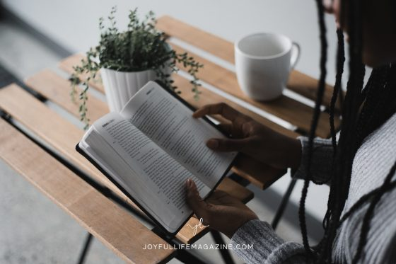 girl reading her bible with coffee