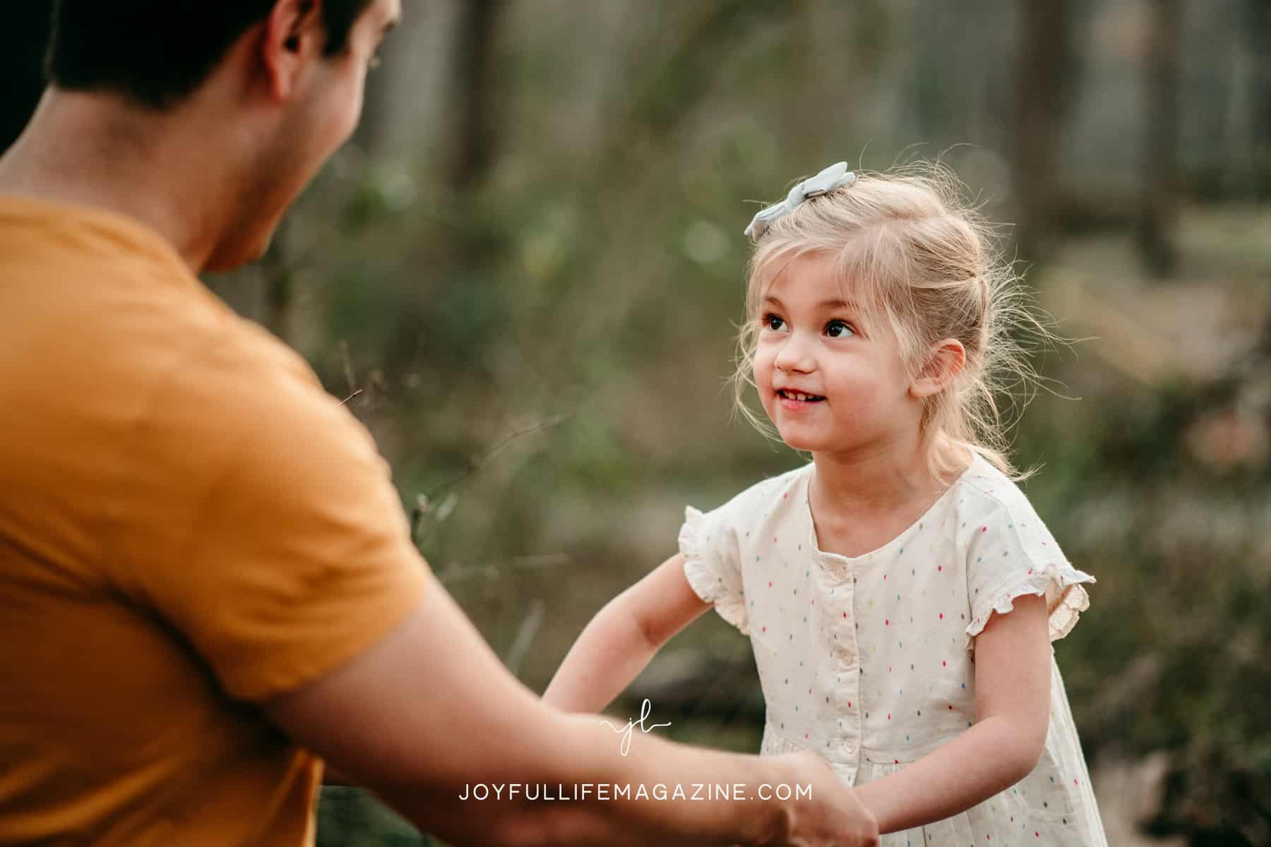 little girl looking up at parent