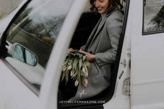 getting out of a car with flowers