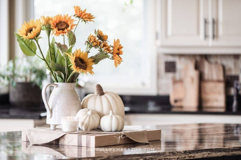 flowers and pumpkins on kitchen counter