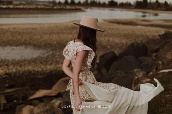 girl in a dress walking along beach