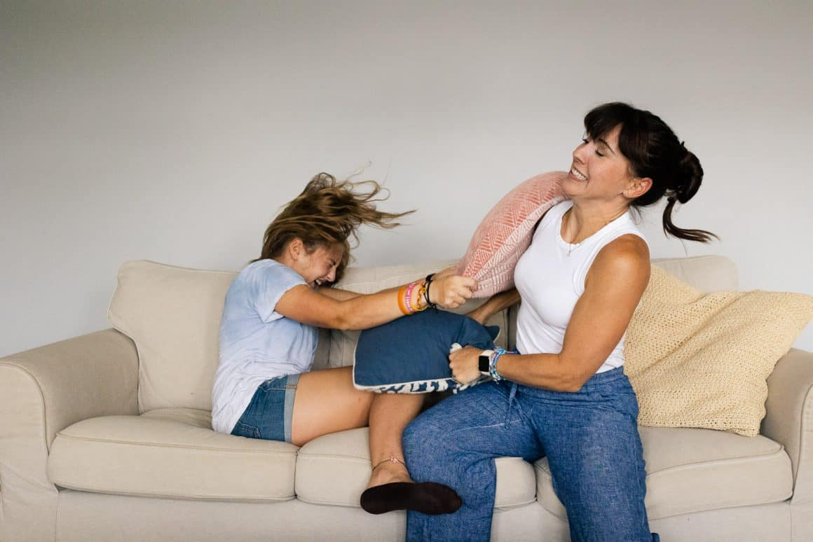 girl fighting with mom on couch