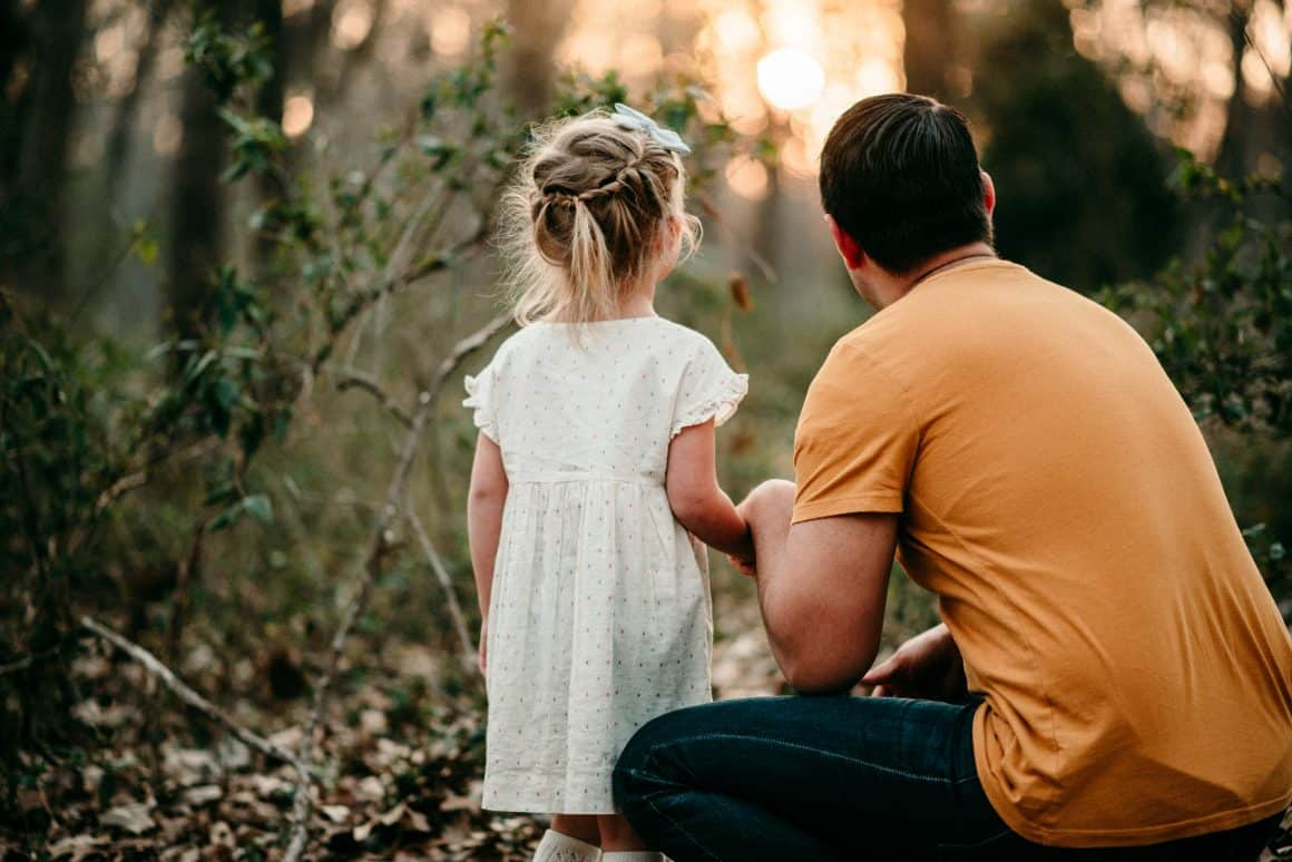 dad next to little girl