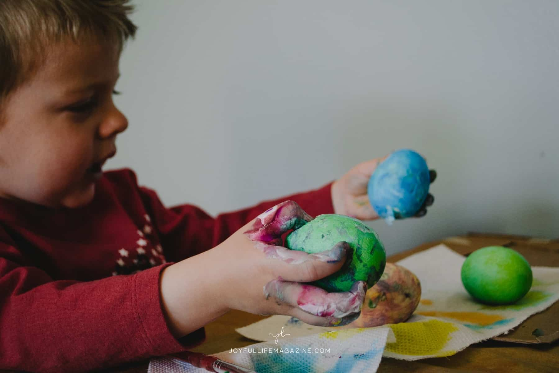 toddler playing with playdough